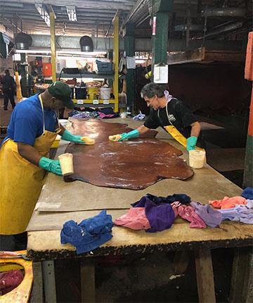 Hermann Oak employees working on Bridle leather